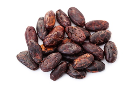 cocoa beans: cocoa beans on white background - food and drink Stock Photo