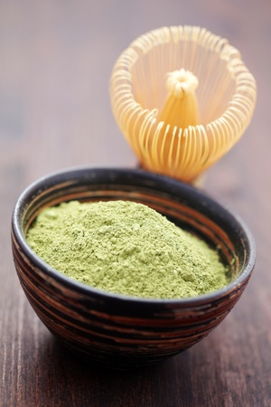 matcha: green powder tea with bamboo whisk - tea time