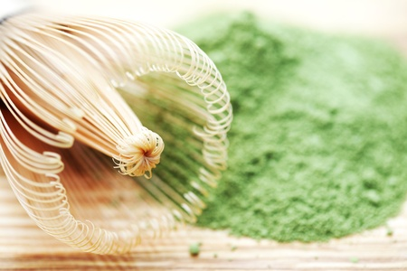 green powder tea with bamboo whisk - tea time photo