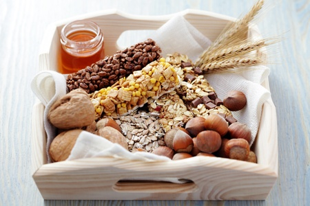 delicious and healthy granola bars with some nuts - diet and breakfast Stock Photo - 8684853