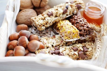 delicious and healthy granola bars with some nuts - diet and breakfast photo