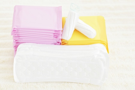 sanitary tampon and towel - beauty treatment photo