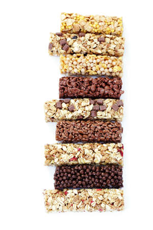 granola bars on white background - diet and breakfast photo