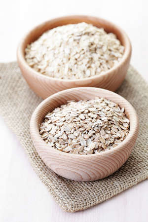 wild oats: bowl full of oats - food and drink  Stock Photo