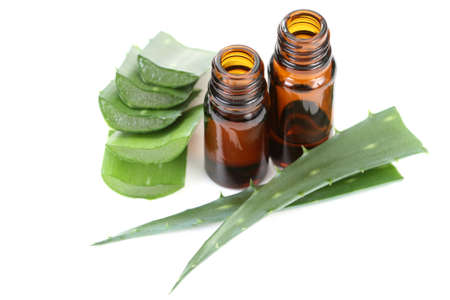 aloe vera flowers: two bottles of aloe vera essential oil isolated on white