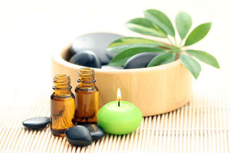 spa and wellness - massage accessories - pebbles and essential oil Stock Photo