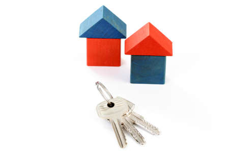 wooden houses and keys isolated on white Stock Photo - 8935678