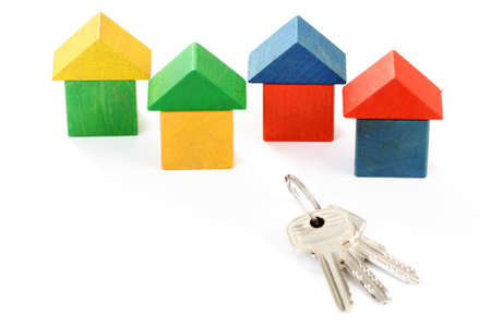 wooden houses and keys isolated on white photo
