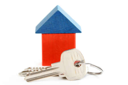 wooden house and keys isolated on white Stock Photo - 8935725