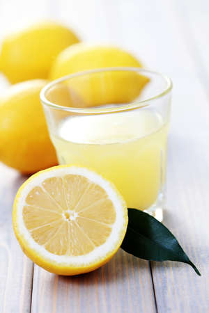 glass of fresh lemon juice with fresh fruits - food and drink photo