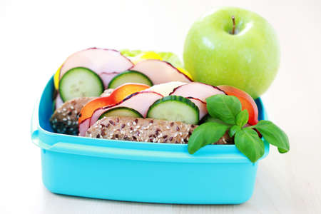 lunch box with delicious sandwich and fruits - food and drink photo