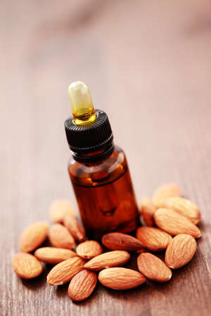 bottle of almond essential oil - beauty treatment photo