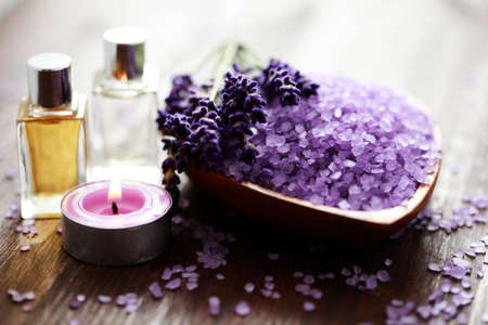 lavender coloured: bowl of lavender bath salt and massage oil - beauty treatment Stock Photo