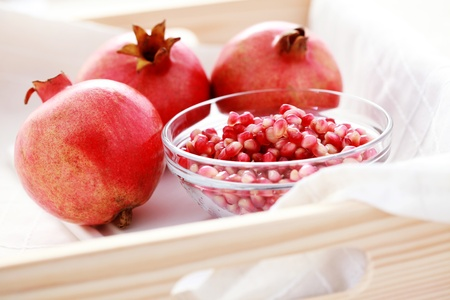 bowl full of fresh pomegranate - fruits and vegetables