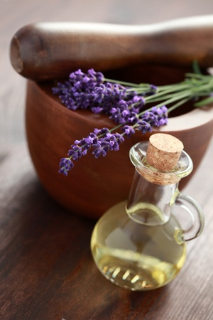 lavender massage oil with mortar and pestle - beauty treatment Stock Photo