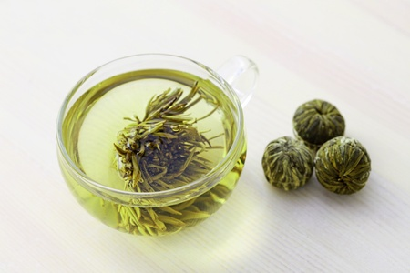 cup of green tea with flower inside - tea time Stock Photo - 9409995