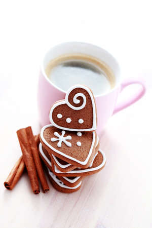 cup of coffee and delicious gingerbreads - seet food photo