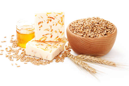 wheat and honey soap on white background - beauty treatment