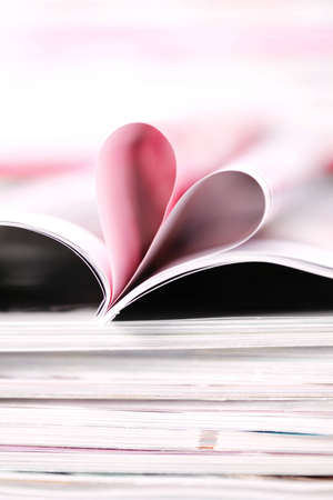 pile of newspapers with heart inside - relaxing time