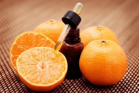 bottle of tangerine essential oil - beauty treatment