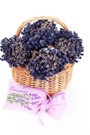 potpourri bag with basket of lavender flowers on white focus on bag photo