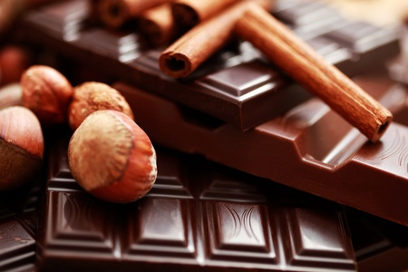 close-ups of chocolate with hazelnuts and cinnamon - sweet food