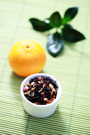 Bowl of tangerine tea with fresh fruit - tea time