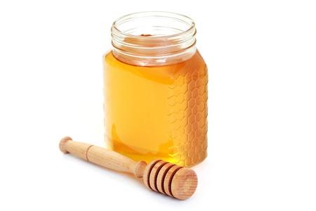 Glas Honig auf weißem Hintergrund - süße Speisen Standard-Bild - 10180184