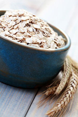 blue bowl full of oats - diet and brekafast photo