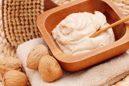 walnut body scrub with some walnuts - beauty treatment Stock Photo