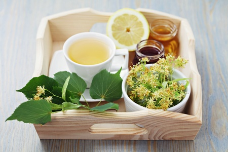 cup of tea and linden flowers - tea time Stock Photo