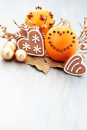 oranges with cloves and gingerbreads with spices - Christmas time