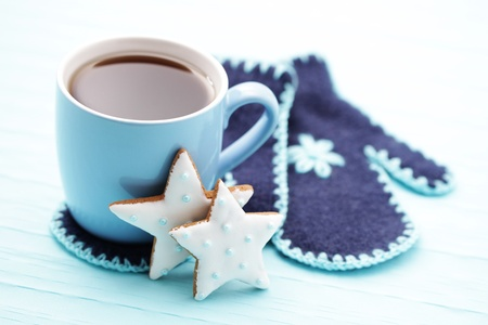 cup of warm tea with gloves and cookies - sweet food photo