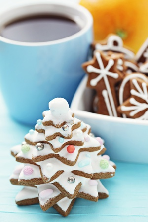 sweet gingerbread tree with cup of tea - sweet food photo