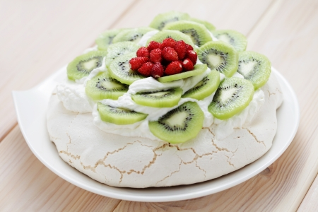 delicious Pavlova with kiwi and wild strawberry - sweet food