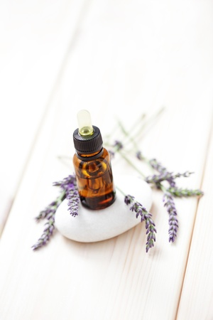 lavender essential oil with fresh flowers - beauty treatment