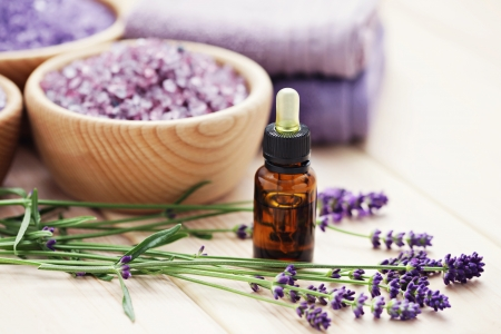 aromatherapy oil andbowl of lavender bath salt - beauty treatment