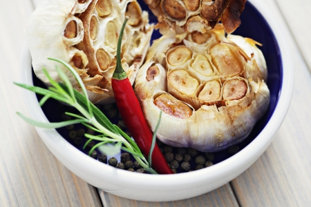 roasted garlic with chilli pepper and rosemary - herbs and spices Stock Photo