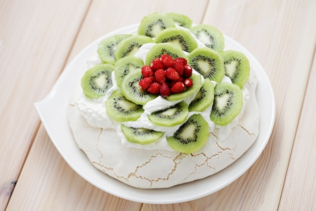delicious Pavlova with kiwi and wild strawberry - sweet food Stock Photo - 17257231