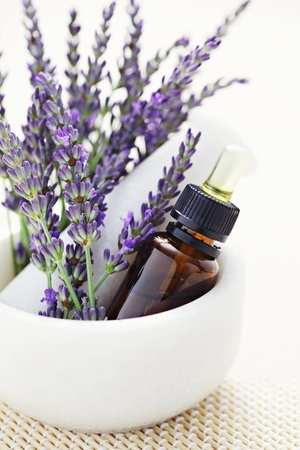 mortar and pestle with lovely lavender flowers - beauty treatment