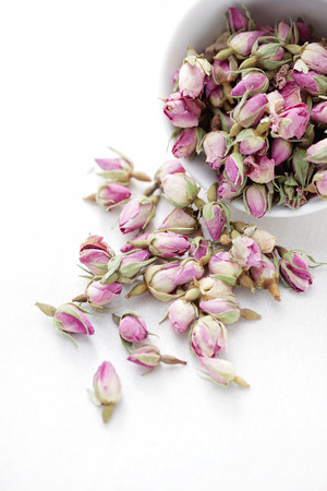 cup full of dried roses - tea time Stock Photo - 24083673