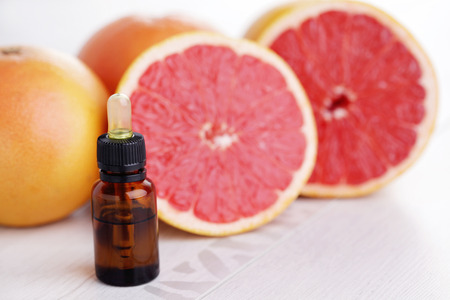 bottle of grapefruit essential oil - beauty treatment