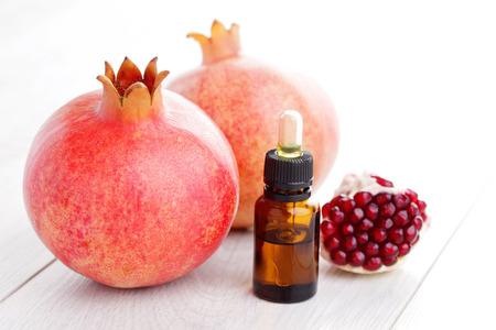 bottle of pomegranate essential oil - alternative medicine Stock Photo