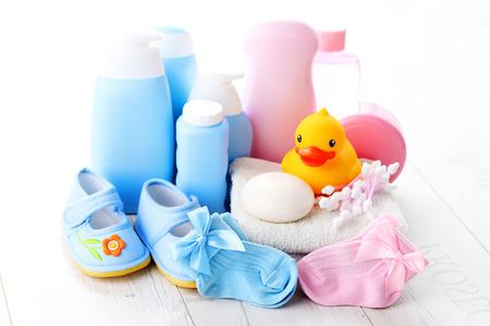 baby accessories on white wood - children Archivio Fotografico