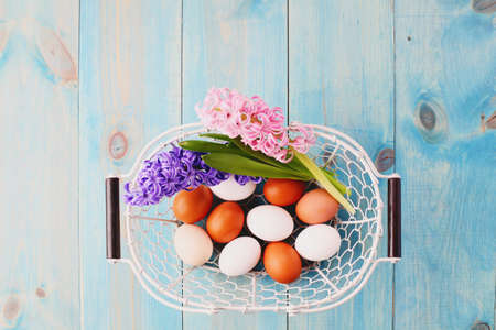blue background with flowers and eggs - Easter time