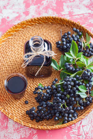 homemade chokeberry juice or liqueur - food and drink