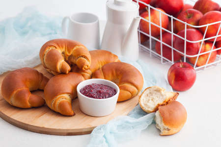 delicious homemade croissants with raspberry jam - food and drink