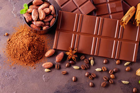 chocolate and cocoa on dark background - sweet food