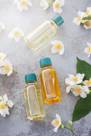 jasmine essential oil with fresh jasmine flowers - beauty treatment
