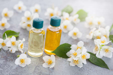 jasmine essential oil with fresh jasmine flowers - beauty treatment